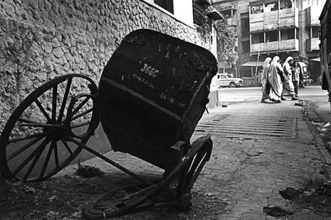 A hand pulled rickshaw the black and white