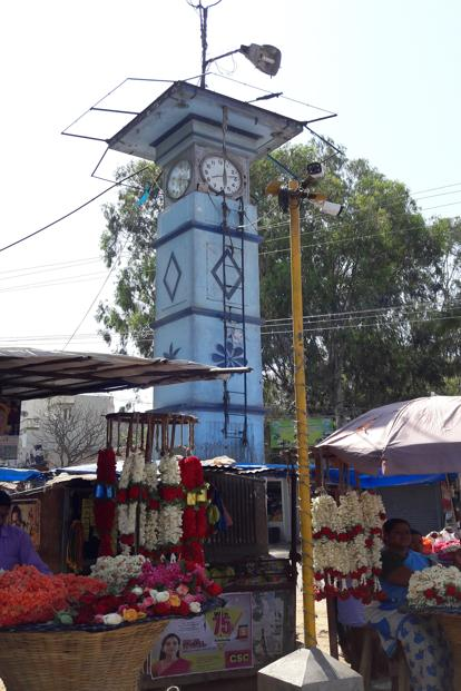 Flower sellers near the clock tower of Dennkanikottai market, where no one bats an eyelid over the beef sold nearby.