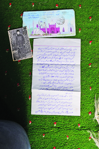 A photograph of Ghulam Hussein and the last letter received by his family.