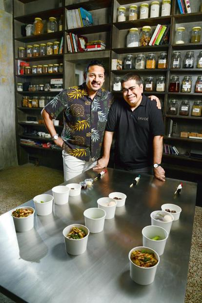 Kanu Gupta (left) and Sushil Multani of Savor with their lunch of the day. Photo: Abhijit Bhatlekar/Mint