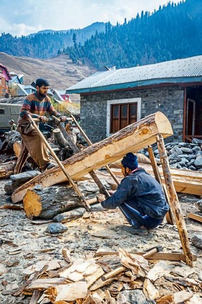 Men chop firewood in Gurez.