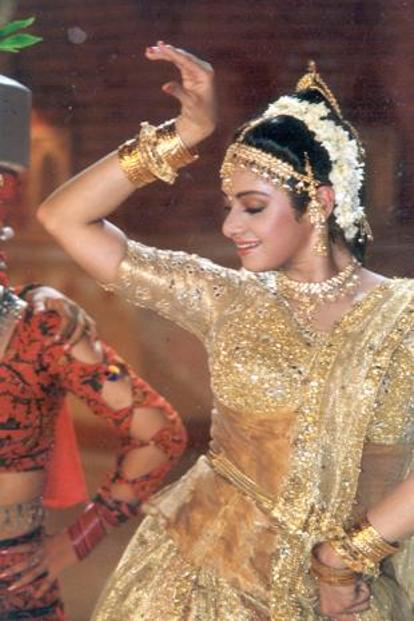 In dance numbers through a range of 1990s films, in which she carried off disastrous costumes with a variety of moves.
