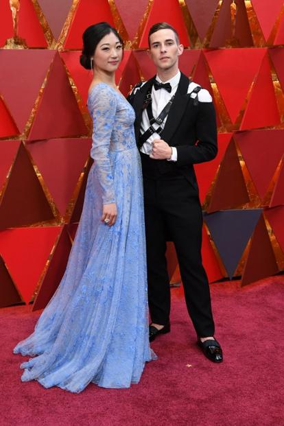 US figure skater Mirai Nagasu (L) and US Olympic medalist Adam Rippon arrive for the 90th Annual Academy Awards in California. Photo: AFP