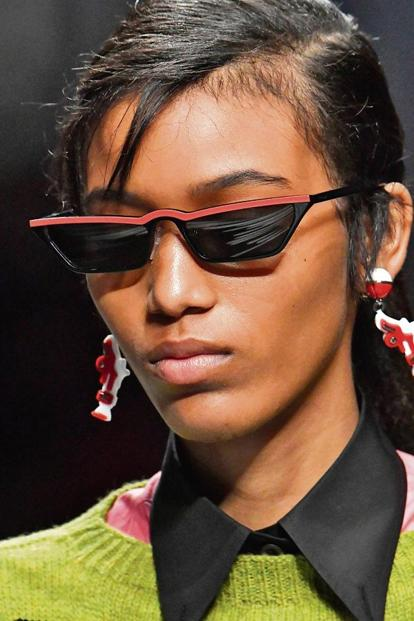 Models in Versace and Prada sunglasses. Photo: Getty Images