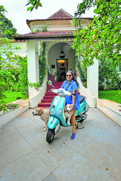 Saloni Puri with her dogs outside The Project Café. Photo: Aniruddha Chowdhury/Mint