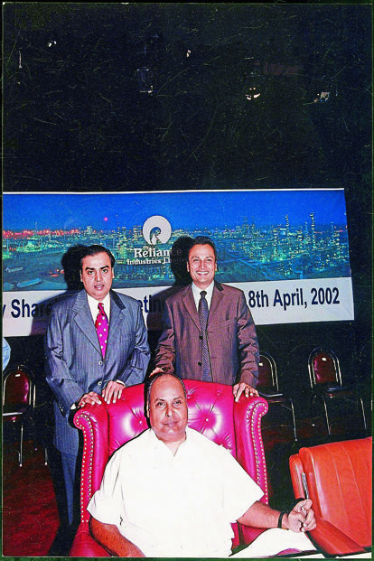Mukesh Ambani (left) and Anil Ambani with their father Dhirubhai Ambani (seated) in 2002. Photo: HT