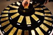 Gold erases gains after Bernanke comments