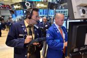 Dow, S&P end at records on Fed officials' reassurance