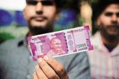 The Reserve Bank of India (RBI) introduced Rs 2000 notes after the 8 November demonetisation move that invalidated high denomination currency notes. Photo: Pradeep Gaur/Mint