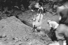 Pitfalls of poverty: Labourers digging a ditch beside a road in Goa as a woman and child look on. Poverty and stress can lead to depression and anxiety, experts say. In India, as in much of the develo