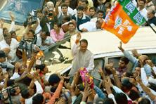 Popularity wave: Shivraj Singh Chouhan waves to his supporters at the state BJP office on Monday. Mahesh / HT