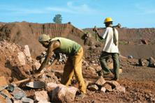 Addressing needs: Labourers dig for iron ore in Orissa. Though CIL has easily extractable reserves, it is looking to partner global metals and mining giants to revive abandoned mines and extract coal