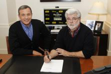 Walt Disney chairman and CEO Bob Iger (left), and filmmaker and Lucasfilm chairman George Lucas at the Walt Disney Co. headquarters in Burbank, California. Reuters