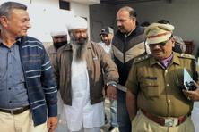 A Delhi police team arresting former Uttarakhand Minorities Commission chairman Sukhdev Singh Namdhari from his residence at Bajpur on Friday in connection with the killings of liquor baron Ponty Chadha and his brother Hardeep. Photo: PTI