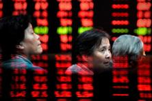 Hopes that China's economy is revving up again after seven straight quarters of slowing growth also boosted riskier assets such as oil and copper. Photo: AFP.