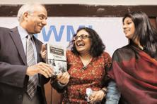 Journalist Meena Menon (centre) launching her works of reportage, Riots and After in Mumbai