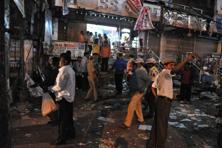 Authorities and onlookers at the site of the bomb blast at Dilshuk Nagar in Hyderabad. According to the initial death-toll, 14 people died and 119 people have been injured in the latest act of terrorism. AFP