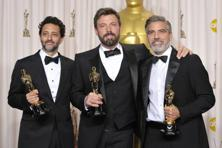 Grant Heslov, left, Ben Affleck, and George Clooney with their award for best picture for 'Argo'. Photo: John Shearer/ AP