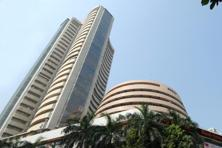 A file photo of the Bombay Stock Exchange. Domestic gains came as part of a global equity rally on the back of the US accommodative monetary policy and expectations of pledges of support for growth from the European Central Bank and the Bank of Japan this week. Photo: Hemant Mishra/Mint