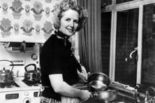 Margaret Thatcher, born in Grantham, central England, on 13 October 1925, poses in the kitchen of her Chelsea home in London, following her 11 February 1975 election as the head of the Conservative Party. Photo: AFP
