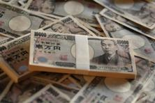The yen rallied on Tuesday, snapping a three-day decline against the dollar and euro as it neared 100 to the dollar. Photo: Yuriko Nakao/Bloomberg