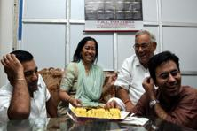 A file photo of Bhardwaj with his wife Ramesh Kumari, and sons Hitesh and Nitesh. Photo: The Indian Express