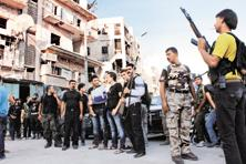 Free Syrian army fighters gather before heading to fight in Aleppo's district of Salaheddine on Saturday. Photo: Reuters