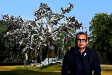 Subodh Gupta with his work 'Dada' at the NGMA, New Delhi. Photo: Priyanka Parashar/Mint
