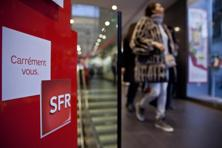 The SFR logo sits on display inside a mobile phone store operated by Vivendi SA in Paris. Photo: Balint Porneczi/Bloomberg