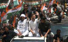 Congress party vice-president Rahul Gandhi waves to the crowd at a roadshow with party candidate Ajay Rai in Varanasi on Saturday. Photo: PTI