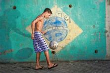 A boy in the favelas or slums of Rio de Janeiro, the Brazilian city that will host the final match. Photo: Buda Mendes/Getty Images