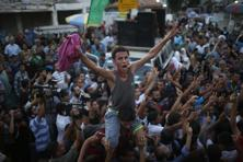 Palestinians celebrate what they said was a victory over Israel following a ceasefire in Gaza City on Tuesday. Photo: Reuters