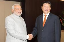Despite his hardline nationalist reputation, India's Prime Minister Narendra Modi moved quickly to engage with traditional rival China after taking office in May, inviting Xi to India.