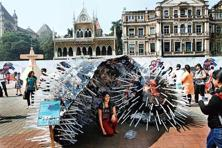 People posing in front of an art installation at the 2013 Kala Ghoda Arts Festival. Photo: Kunal Patil/Hindustan Times