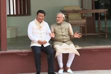 A handout photograph of Chinese President Xi Jinping (left) and Indian Prime Minister Narendra Modi at the Sabarmati Ashram in Ahmedabad. Photo: AFP