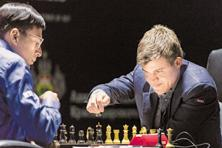 Magnus Carlsen makes a move against Viswanathan Anand in Sochi on Sunday. Photo: Artur Lebedev/AP
