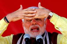 It should not be surprising at all that Narendra Modi has failed to deplore wholeheartedly his supporters' statements, let alone to make them firing offences. Photo: AFP