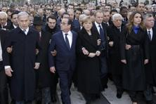 French President Francois Hollande is surrounded by heads of state as they attend the solidarity march (Marche Republicaine) in the streets of Paris. Photo: Reuters