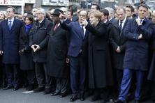 French President Francois Hollande is surrounded by other heads of state as they attend the solidarity march in the streets of Paris on Sunday. Photo: Reuters