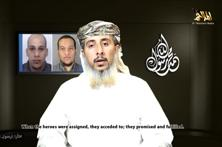 Nasser bin Ali al-Ansi, a leader of the Yemeni branch of al Qaeda (AQAP), speaks as an image of brothers Cherif Kouachi (rear left) and Said Kouachi (rear right), is seen in this still image taken from a social media website. Photo: Reuters