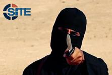 A masked, black-clad militant, who has been identified by the Washington Post newspaper as a Briton named Mohammed Emwazi also called 'Jihadi John,' brandishes a knife in this still image from a 2014 video obtained. Photo: Reuters
