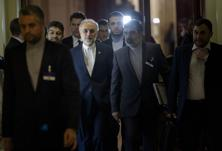 Iran's Ali Akbar Salehi walks with others during a break in a meeting with world powers representatives seeking to pin down a nuclear deal with Tehran at the Beau Rivage Palace Hotel, 31 March 2015 in Lausanne. Photo: AFP