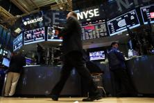 The Dow Jones rose 32.16 points, or 0.18%, to 18,042.84, the S&P 500 gained 2.63 points, or 0.12%, to 2,110.02 and the Nasdaq added 2.93 points, or 0.06%, to 5,072.96. Photo: Getty Images/AFP