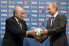 Russia's President Vladimir Putin (right) and FIFA President Sepp Blatter take part in the official handover ceremony for the 2018 World Cup scheduled to take place in Russia, in this file picture taken in Rio de Janeiro, Brazil, 13 July 2014. Photo: Reuters