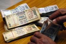 The rupee opened at 64.08 and fell to as low as 64.30 per dollar. Photo: Mint