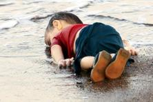 "The death of little Aylan Kurdi can't be reversed. But thanks to Nilufer Demir, it has served to remind us that wars lead to human tragedies, not just ""collateral damage"". Photo: Nilufer Demir/DHA/Reuters"