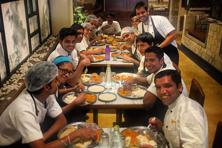 The staff sit down to dinner at The Bombay Canteen. Photo: Courtesy The Bombay Canteen