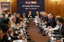 Indian Prime Minister Narendra Modi and British counterpart David Cameron with business leaders from both countries. Photo: AFP