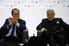 French President Francois Hollande (left) and Prime Minister Narendra Modi attend the launching of the International Solar Alliance on the opening day of the World Climate Change Conference 2015 (COP21) in Paris on 30 November. Photo: Reuters