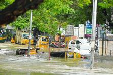 A file photo of a locality in Chennai during the floods. Floodwater and power cuts downed ATMs in flood-affected areas in the state and there was no way to load cash in the ones that were working. Photo: PTI